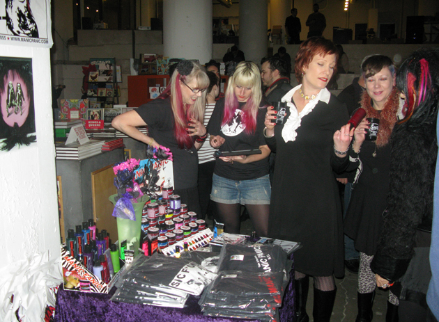 Actress Ann Magnuson (blouse) scoring merch from Manic Panic. Pic: DeRienzo